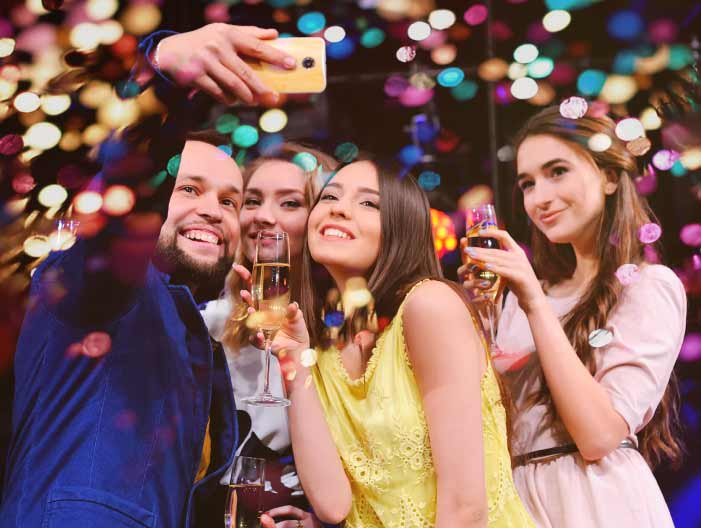 Group selfie with glitter and champagne