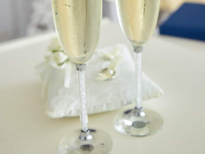 Toasting glasses with wedding bands